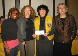 President Terry Fontana & Lydia Manget present cheque to Emily Stowe staff
