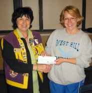 President Terry Fontana presents cheque to Michele Hull for pee wee baseball